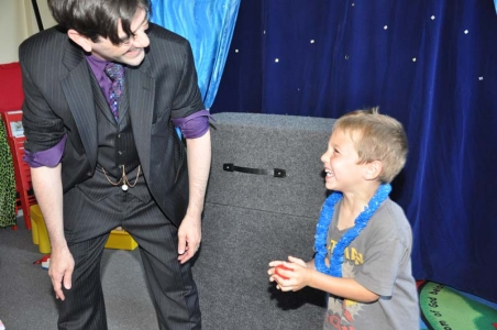 Child smiling at a magic trick