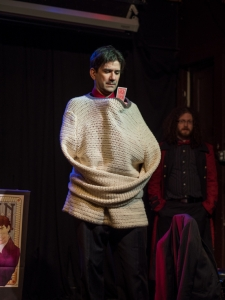 Evan in his knitted straitjacket