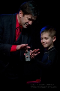 boy helping with magic trick
